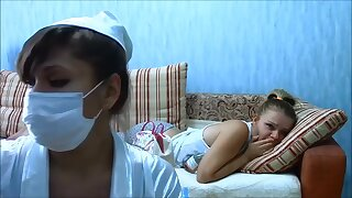 In this fetish video a very sexy nurse with enormous boobs comes to take care of her patient. She takes really good care of the girl and makes an injection to her parking place.